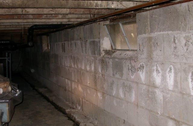 efflorescence on foundation wall